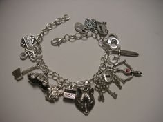 Grimm TV show fans -  theme charm bracelet with pewter charms on Silver plated bracelet  by Suzq Chic 2015, $24.95