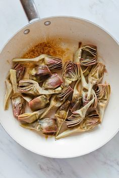 Artichokes Venetian style, braised in wine and olive oil and topped with mint. From an Elizabeth David's recipe.