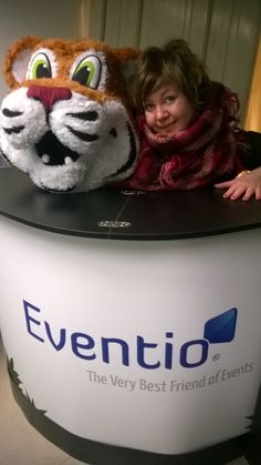 Our client Eventio and it´s own tiger character, and Tarinakone´s founder story designer Anne.