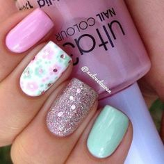 pink, mint, and white nails with a pink glitter nail