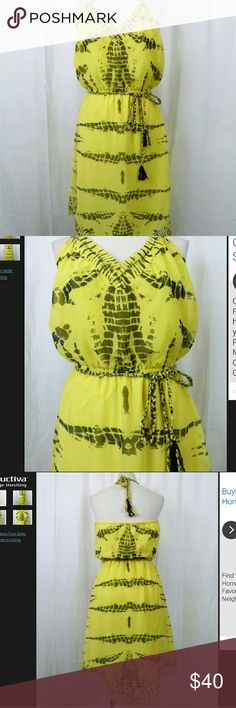 Halter dress with tassel rope belt size XS Beautiful dress with halter neck and open back.  Ties around the neck with a tassel rope tie. Attached tassel belt. Pretty yellow and black print. fully lined with asymmetrical hemline. New York & Company Dresses