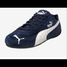 2c452aaa65b053 Shop Women s Puma Blue White size Athletic Shoes at a discounted price at  Poshmark. Description  Dark blue and white men s Puma sneakers.