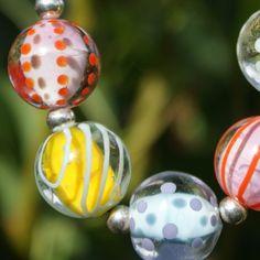 Perle e Popette - Chupa-Chups, Collier de perles de verre, et perle d'argent.