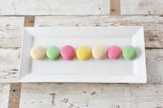 macarons on white tray by greenleafimages