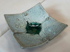 hand built slab pottery. played with crushed glass at the bottom. the colours all blended but I like the finished look!