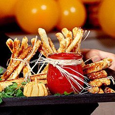 Breadstick Haystacks - Halloween Party Appetizers and Finger Food - Southernliving. Recipe:Breadstick Haystacks  You'll be eating these rather than looking for anything when you see these tasty Breadstick Haystacks. Simple to take from oven to table, these are light, crunchy, and always a perfect party food. This recipe adds a little spice to the simple breadstick too, Dressing up plain breadsticks with a sprinkling of dry Ranch dressing mix before baking them in the oven. Once out, you'll…
