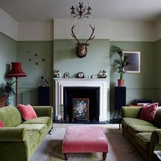 GO GREEN  Green is an often overlooked choice for a living room. Here (a real home in London's Bethnal Green), the spectrum from sage to pretty pea green is explored, all accented with contrasting rose pinks and scarlet reds.   shootfactory.co.uk