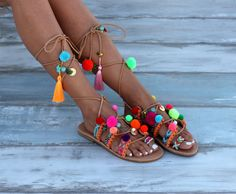 "Handmade leather sandals, Chili Mango We sew by hand the leather straps with handmade friendship bracelets in vibrant colors and motifs and colorful fluocent pom poms. ""Chilli mango"" are embellished with semiprecious stones, gold-plated coins, pom poms, multicolored charms and tassels. One of our classic pom pom sandals collection, very playful and colorful, they will make you feel happy every time you wear them! A necessary summer accessorie for all the optimistic women who really enjoy…"