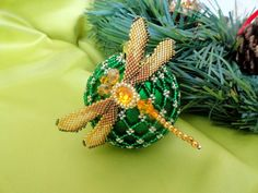 Samosudova Anna is talented beadwork artist who makes amazing Christmas Balls and ornaments, decorated with Beaded Christmas Ornaments, Christmas Baubles, Christmas Decorations, Fabric Ornaments, Hand Painted Ornaments, Beaded Ornament Covers, Xmas Pictures, Beaded Crafts, Holiday Crafts