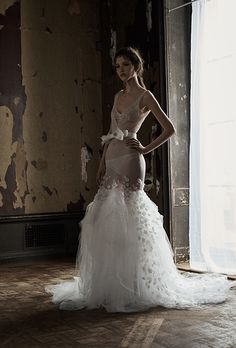 A sheer tulle fit and flare wedding dress by @verawanggang | Brides.com