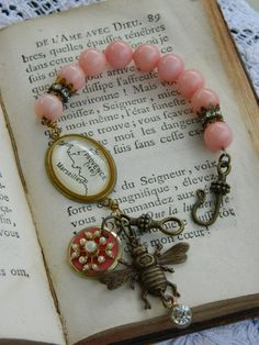vintage assemblage jewelry handmade bracelet paris provence french map bee pink rose by atelier paris on etsy