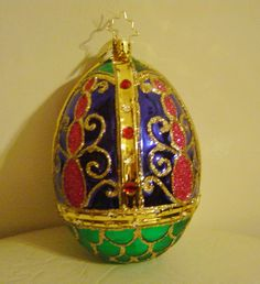 Exquisite rare Christopher Radko Large Faberge Egg ornament, retired, new with Radko Box. Stunning in its beauty, the egg is hand blown glass, lined with sterling silver, hand painted and bejeweled, glittered, and decorated
