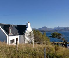 The Croft House is a beautifully refurbished detached house in an elevated position above Gairloch Bay, with stunning views of the Torridon Mountains and Skye. Scottish Holidays, Solid Fuel Stove, Wester Ross, Unique Cottages, Highland Village, Local Events, Ceiling Beams, White Houses, Double Beds