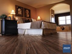 American Estates 9x36 Wood Look Tile Plank Flooring shown in the Spice color | Available at Avalon Flooring | Starting at $5.69/square foot | #woodlooktile #bedroomdesign #bedroomtilefloors #tileflooring