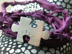 Hand-crafted silver puzzle piece Autism Awareness bracelet (this one custom stamped with H A L O) by Sugarplumkate on Etsy.  www.etsy.com/Sugarplumkate  www.facebook.com/SugarplumsJewelry Thank you Katelynne for supporting this cause!