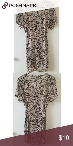 Leopard Print Sheer Swimsuit Cover Up Leopard print sheer swimsuit cover up by H&M. So cute! Perfect condition, worn once to the beach. You could wear it as a dress with a tank top underneath.  Size: XS (fits up to medium).  Tan & Black 100% Polyester  Made in Cambodia H&M Swim Coverups