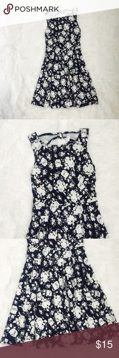 Navy Floral Dress with Cute Bow Back Cute dress in great condition, worn once for Easter. Navy blue with white flowers that have grey shading. Xhilaration Dresses