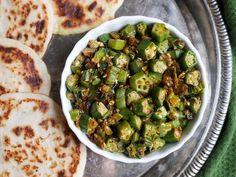 This crispy Indian okra recipe is a popular dish also known as bhindi. It's a tasty way to make and enjoy okra. This recipe has the power to convert okra haters!