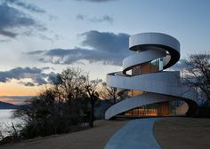 Two curving staircases encircle the exterior of this wedding chapel.