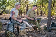 US Army Officer Lieutenant Shelby Blad and Australian Army Trooper Dean Hassall are crafting Digging sticks as part of Outback survival training (Exercise Kowari)[3600x2400]
