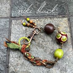 Made this bracelet using wood beads, glass beads, recycled sari ribbon and more.   -Niki Black