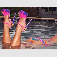 Some people be thinking of the shoes... I'm thinking of, why is she wearing them while swimming???