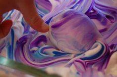 Cool Whip Egg Dye- 1. Spread Cool Whip on cookie sheet 2. Apply drops of neon food coloring or use Kool-aid 3. Use toothpicks to swirl colors around 4. Roll dried, cooled hardboiled eggs colorful cream (use disposable gloves to reduce tattoo effect) 5. Allow to set for 3-4 minutes on a paper plate 6. Wipe off Cool Whip 7. Rinse! Voila!  Beautiful marbleized eggs, done quickly!