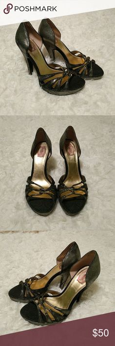 Hale Bob high heels Used, very good condition Hale Bob Vero Cuoio gold/black metallic heels!    Super cute for a night out on the town!   Heel is about 3.5 inches.  Size: Women's 7  🎉15% off when you bundle 3 or more items from my closet! Hale Bob Shoes Heels
