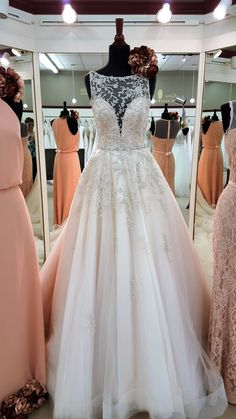 Gorgeous high illusion neckline on this beaded bridal gown!