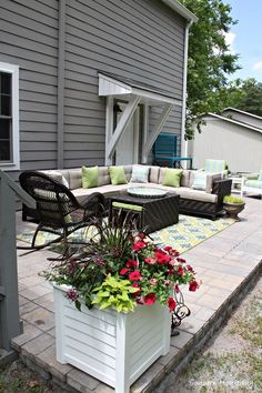 s 15 ways concrete pavers can totally transform your backyard, concrete masonry, curb appeal, outdoor living, Stack some into a raised patio