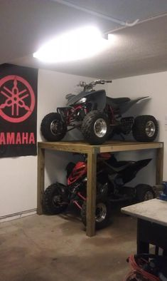 I live in town and have developed a space issue. I have a deep stall garage but didn't have enough room for 4 wheeler's. Even with a bigger garage I was. Garage Storage Racks, Garage Organization, Storage Shelves, Storage Spaces, Quad Bike Storage, Organization Ideas, Organizing, Kayak Storage, Dirt Bike Room