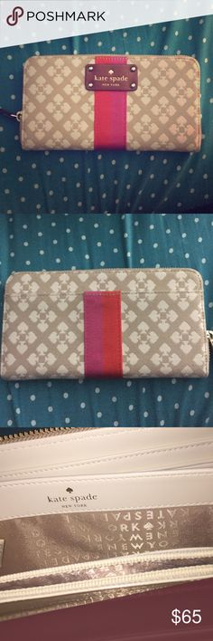 EUC Kate Spade wallet EUC.Auth KateSpade; Cream wallet with pink and orange accent very spacious, barely used. No stains or rips. Inner coin pocket. kate spade Bags Wallets