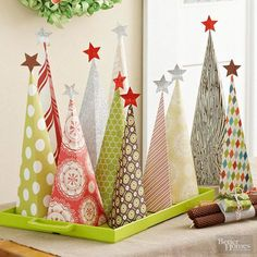 Imagine a little forest of these fun paper trees among your Christmas mantel decor or as a dining table centerpiece. Our free patterns make this Christmas crafts simple.