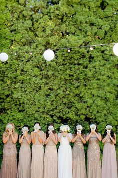 These mismatched bridesmaid dresses are so pretty! (and what a great photo idea,… These mismatched bridesmaid dresses are so pretty! (and what a great photo idea, too) Mismatched Bridesmaid Dresses, Bridesmaids And Groomsmen, Wedding Bridesmaid Dresses, Sparkly Bridesmaids, Different Colour Bridesmaid Dresses, Embellished Bridesmaid Dress, Mix Match Bridesmaids, Funny Bridesmaid Photos, Autumn Bridesmaids