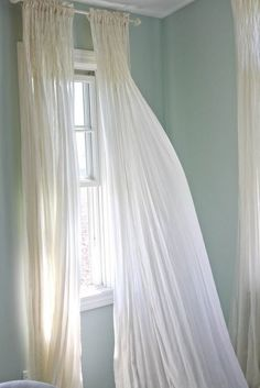 House of Turquoise: Whitewashed Tiffany Bedroom. palladian blue Note the curtains and where the rod is House Of Turquoise, Palladian Blue Benjamin Moore, Tiffany Bedroom, Bleu Pastel, Azul Tiffany, Cottages By The Sea, Beach Cottages, White Curtains, Muslin Curtains