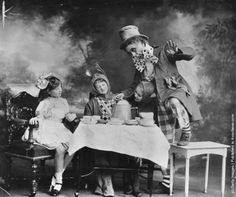 """The Mad Hatter's tea party, a scene from a theatre production of """"Alice In Wonderland"""". (Photo by Hulton Archive/Getty Images). Circa 1910"""
