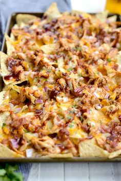 Sheet Pan BBQ Chicken Nachos are unbelievably delicious! Chips topped shredded chicken, cheddar and Monterrey Jack cheese, red onion and bacon! Bbq Nachos, Chicken Nachos Recipe, Pulled Pork Nachos, Chicken Recipes, Bbq Chicken Salad, Chicken Dips, Quesadillas, Cooking Recipes, Skillet Recipes