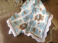 Blue And Brown Elephant Fleece Baby Blanket With A White Crocheted Edging