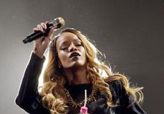 A Harlem woman claims in a lawsuit that she got herpes at a Rihanna concert in Brooklyn from lipstick the singer endorsed.