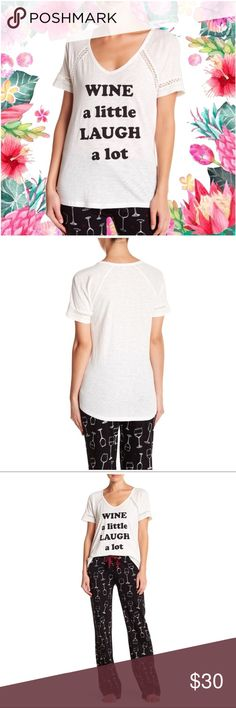 """PJ SALVAGE Lace Detail Graphic Print Tee IVORY PJ SALVAGE Lace Detail Graphic Print Tee IVORY  Details Lace details add a hint of elegance to this graphic print tee.  - V-neck - Short raglan sleeves with cutout lace detail - Front graphic print - Curved hi-lo hem - Approx. 24.5"""" shortest length, 26.5"""" longest length (size S)   Fiber Content 55% cotton, 45% rayon  Care Machine wash cold  Additional Info Fit: this style fits true to size.  Model's stats for sizing: - Height: 5'6"""" - Bust: 34""""…"""