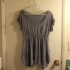 Gray cotton tunic Used condition. Cinched at the waist, has belt loops (doesn't come with belt). One small hole at the bottom, barely visible (see last picture). Charlotte Russe Tops Tunics