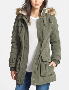 Loving this green coat with utility details and faux fur for fall. The detachable hood and drawstring waist that cinches allows for versatile wear.