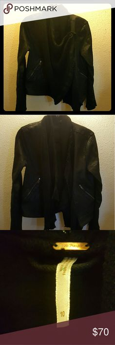 Drape Front Jacket Very stylish jacket from Free People. It has coated black denim with a leather look, and a built in drape scarf that buttons on the left side. Functional zipper pockets in from and zippers on sleeves. 27 inches long. It has been worn a few times, but is still in great shape. It makes a great fall jacket with a rocker vibe. It is a fairly tight fitting jacket, but I would say it is a true size ten. I really love this jacket, but it's just too big for me now. Free People…