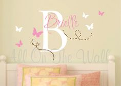 This name and initial surrounded by fluttering butterflies is adorable for any girls room!    The initial will measure approximately 22 tall.