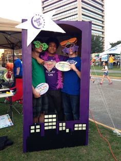 Relay for Life Photobooth. Such a cute idea...reminds me of all the figures and dolls we have bought through the years. :)