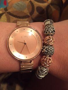 Rose tone watch with pandora bracelet