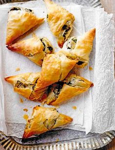 Spinach, feta and onion parcels Spinach puff pastry pies and feta are a classic combination and work really well with the zing of preserved lemon. Try it in these vegetarian filo parcels which make a great, simple starter, snack or lunch Vegetarian Recipes, Cooking Recipes, Vegetarian Tapas, Vegetarian Appetizers, Pastry Recipes, Cooking Food, Sausage Recipes, Easy Starters, Good Food