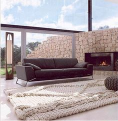 Want this awesome knit rug and look at the tiny ottoman on it.....Now thats a big rug.