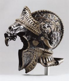 "Burgonet ""ALLA ROMANA ANTICA"" Created for The Archduke Ferdinand II of Tyrol, Ambrass and Innsbruck.  Ceremonial Parade Helmet designed and created by the famed studio of Filippo Negroli, a 16 Century Armorer in Milan, Italy.  Bronze, Steel, Gold and Brass."
