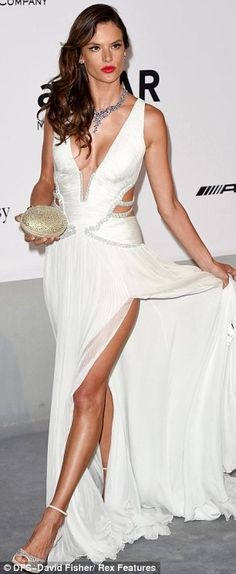 She may be one of the Victoria's Secret Angels but there was nothing angelic about Alessandra Ambrosio's appearance at the annual amfAR Cinema Against AIDS gala in Cannes on Thursday.  The Brazilian beauty arrived at the fundraiser in a daring Robert Cavalli gown which barely covered more than the lingerie she models for VS.